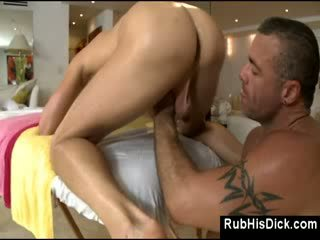 Gay bear fucks guy in his ass on massage table