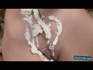 Sexy young Abelinda smothers her tits and twat in cream and frigs her clit
