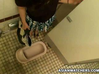 Asian schoolgirl masturbates in her schools bathroom