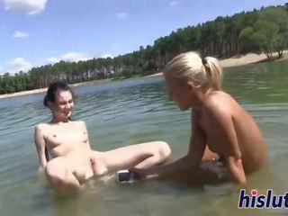 Two hot lesbians bang at the beach