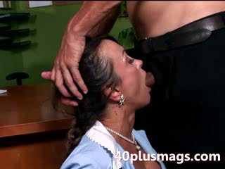 Cleaning lady does office worker