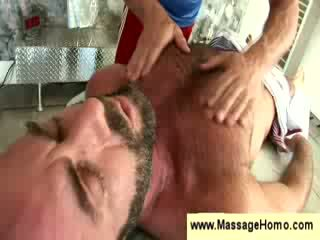 Gay masseuse squeezes a guys butt