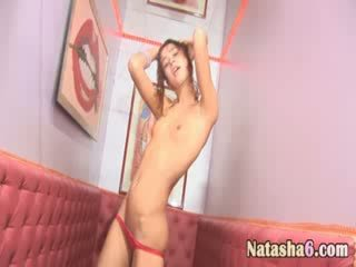 Naked brunet in disco club