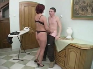 Redhead MILF Gets Anal From A Young Man On The Stairs