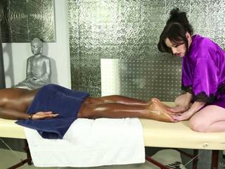Pale-skinned elegant masseuse and ireng man.