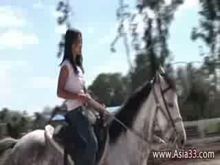 My naked asian girlfriend riding horse