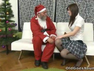 Old santa clause gives young rumaja a gift