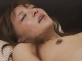 Japanese MILF is rubbing a cock