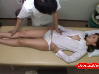 Office Lady Getting Her Small Tits And Pussy Rubbed By The Masseur On The Massage Bed