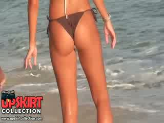 The tight bikini booty of hot chick is sexily shaking when she is playing with a ball
