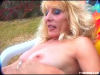 Granny toys her pussy