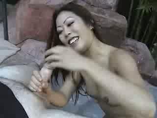 Hot asian in bikini gives a blowjob