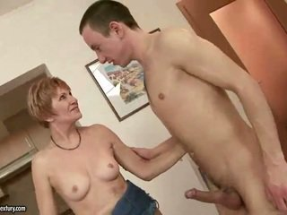 Granny sucking and riding young cock