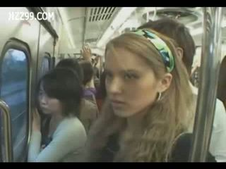 Two anthomaniac girls in train gives geek handjob