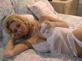 Jenna J solo on bed in white lingerie
