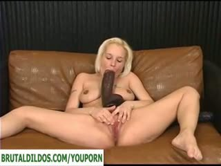 Blonde opens her pussy with brutal dildo