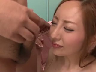 Oriental babe toying and blowing
