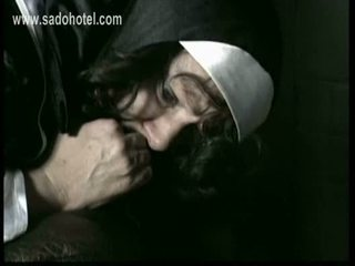 Beautiful nun slave bends over with her panties down is span