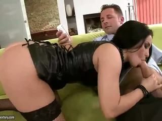 Sexy brunette fucking two guys