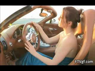 Hot glamour babe Meghan is driving a car