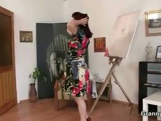 Mature paintress takes it from behind