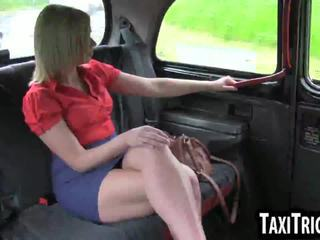 Foxy blonde babe sucking cock in back of a taxi