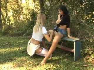 Carla Novaes drills a chick outdoors