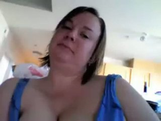 Busty Teacher lets her heavy tits fall out of her blue dress