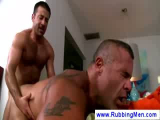 Mature masseur sits on top