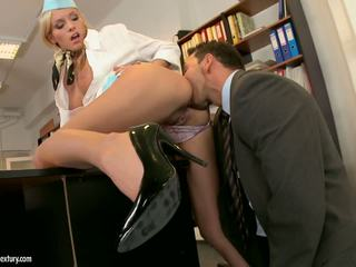 Sexy stewardess visits chief's office.