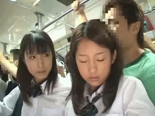 Two schoolgirls пипнешком в а автобус